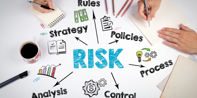 Risk management concept. The meeting at the white office table.